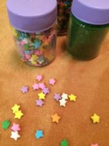 Cake sprinkle or confetti add color to a tablecloth.