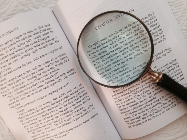 Magnifying glass on a chapter of Glimmer