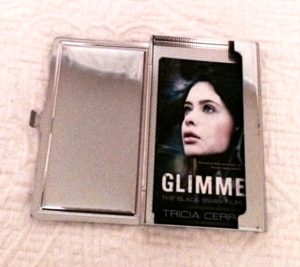 A silver business card holder that slides into your purse and also has a mirror to check your smile before handing out a card.